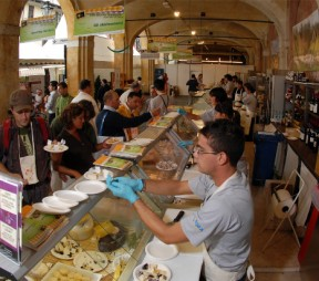 Tasters try samples of cheese in the Gran Sala at last year;s event in Bra, Italy. Image courtesy of Slow Food.